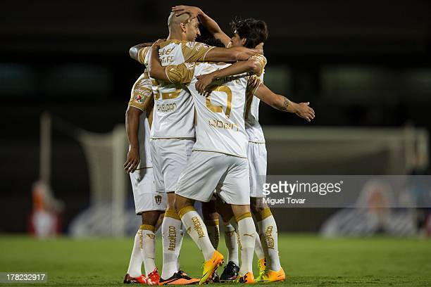 Ariel Nahuelpan and his teammates of Pumas celebrate a goal against Atletico San Luis during a match between Pumas and Atletico San Luis as part of...
