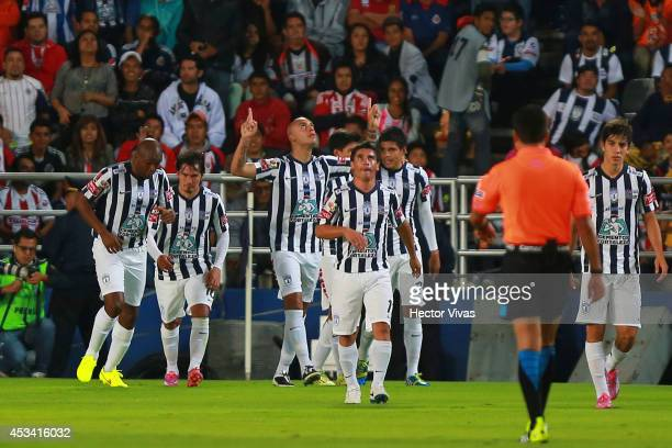 Ariel Nahuelpan of Pachuca celebrates with teammates after scoring the first goal of his team during a match between Pachuca and Chivas as part of...