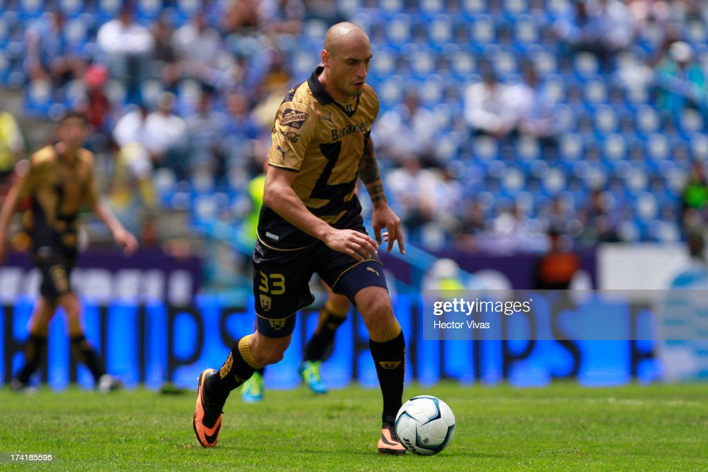 Ariel Nahuelpan of Pumas controls the ball during a match between Pumas and Puebla as part of the Torneo Apertura 2013 Liga Mx at Cuauhtemoc Stadium on July 21, 2013 in Puebla, Mexico.