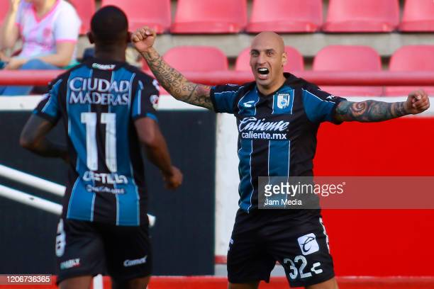 Ariel Nahuelpan of Queretaro celebrates after scoring the third goal of his team during the 6th round match between Neaxa and Queretaro as part of...