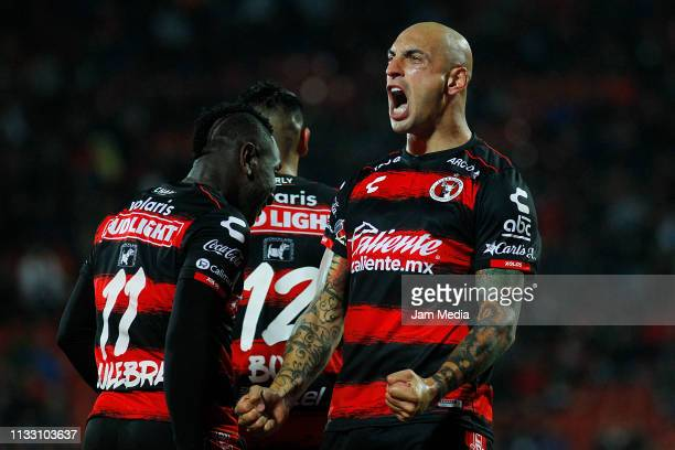 Ariel Nahuelpan of Tijuana celebrates after scoring the second goal during the 9th round match between Tijuana and Atlas as part of the Torneo...