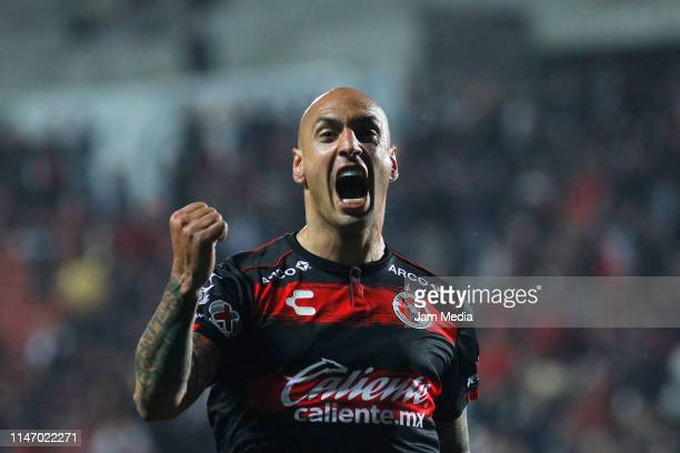 Ariel Nahuelpan of Tijuana celebrates after scoring the third goal of his team during the 17th round match between Tijuana and Puebla as part of the...