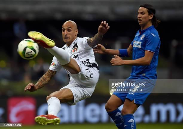 Ariel Nahuelpan of Tijuana is challenged by Igor Lichnovsky of Cruz Azul during their Mexican Clausura football tournament match at the Azteca...
