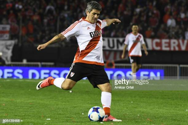 Ariel Ortega kicks the ball during Fernando Cavenaghi's farewell match at Monumental Stadium on July 01 2017 in Buenos Aires Argentina
