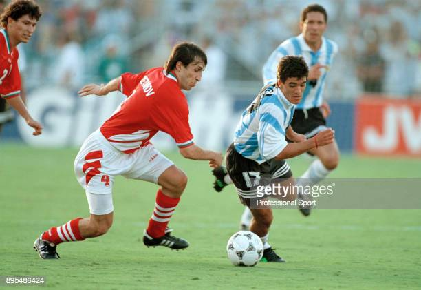 Ariel Ortega of Argentina and Tsanko Tsvetanov of Bulgaria in action during a 1994 FIFA World Cup group game at the Cotton Bowl on June 30 1994 in...