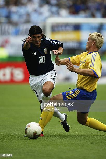 Ariel Ortega of Argentina beats Marcus Allback of Sweden during the Argentina v Sweden Group F World Cup Group Stage match played at the Miyagi...