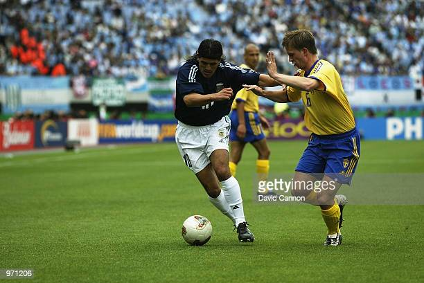 Ariel Ortega of Argentina holds off Tobias Linderoth of Sweden during the Argentina v Sweden Group F World Cup Group Stage match played at the Miyagi...