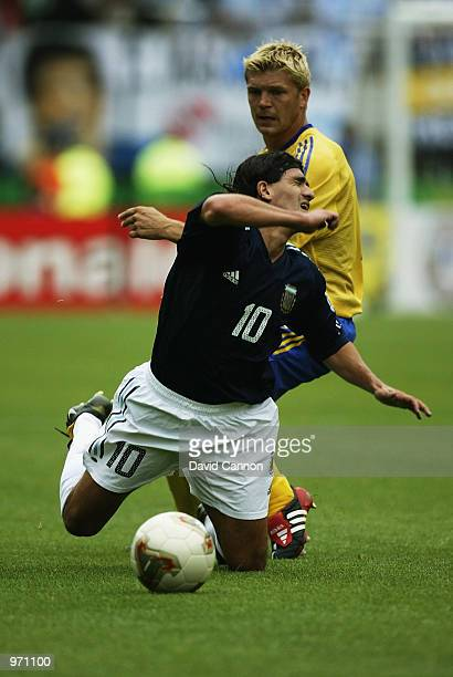 Ariel Ortega of Argentina is brought down by Marcus Allback of Sweden during the Argentina v Sweden Group F World Cup Group Stage match played at the...