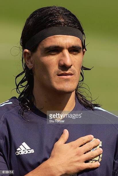 Ariel Ortega of Argentina lines up during the national anthems before the Group F match against Nigeria of the World Cup Group Stage played at the...