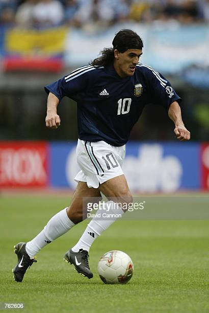 Ariel Ortega of Argentina runs with the ball during the FIFA World Cup Finals 2002 Group F match between Argentina and Sweden played at the Miyagi...