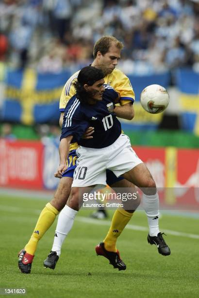 Ariel Ortega of Argentina shields the ball from Teddy Lucic of Sweden during the Group F match of the World Cup Group Stage played at the Miyagi...