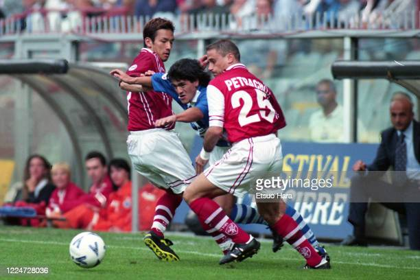Ariel Ortega of Sampdoria competes for the ball against Hidetoshi Nakata and Gianluca Petrachi of Perugia in action during the Serie A match between...
