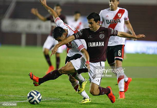 Ariel Rojas of River Plate fights for the ball with Carlos Araujo of Lanus during a match between Lanus and River Plate as part of ninth round of...