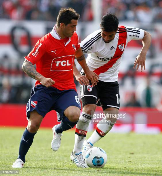 Ariel Rojas of River Plate fights for the ball with Hernan Fredes of Independiente during a match between River Plate and Independiente as part of...