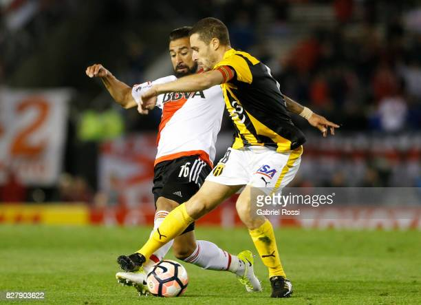 Ariel Rojas of River Plate fights for the ball with Marcelo Palau of Guarani during a second leg match between River Plate and Guarani as part of...