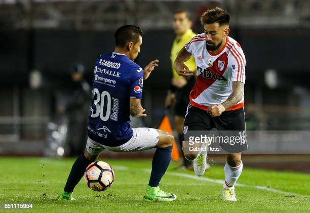 Ariel Rojas of River Plate fights for the ball with Rudy Cardozo of Wilstermann during a second leg match between River Plate and Wilstermann as part...