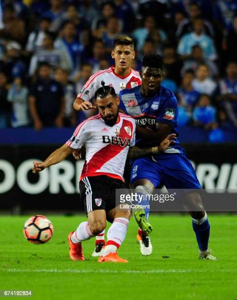 Ariel Rojas of River Plate fights the ball with Marlon de Jesus of Emelec during a group stage match between Emelec and River Plate as part of Copa...