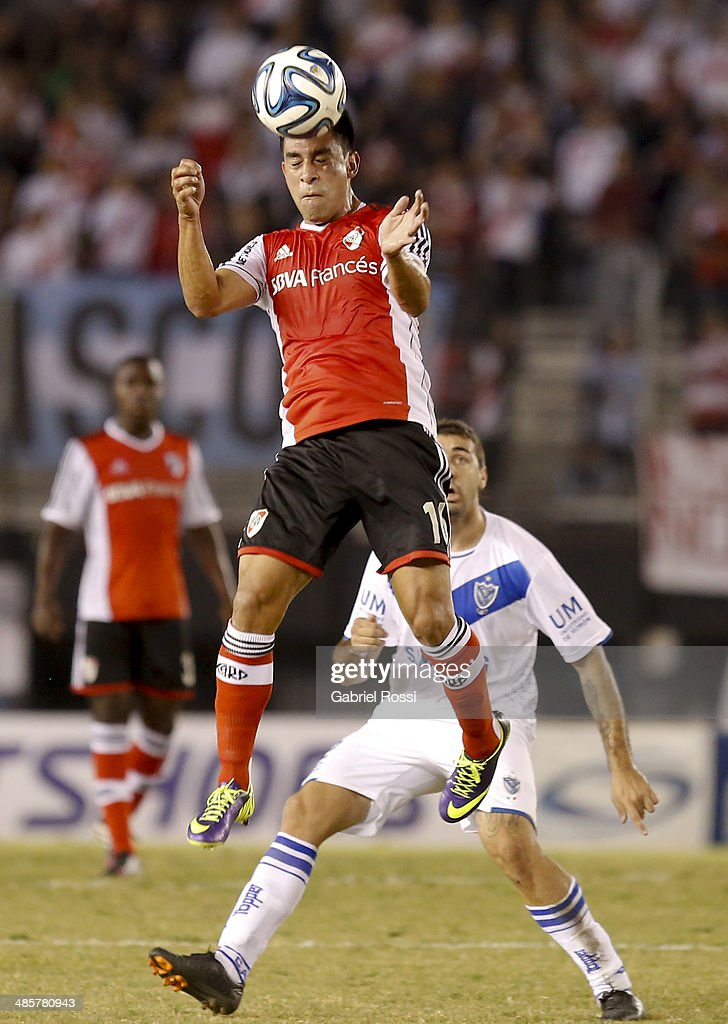 Ariel Rojas of River Plate heads the ball during a match between River Plate and Velez Sarsfield as part of 15th round of Torneo Final 2014 at Monumental Antonio Vespucio Liberti Stadium on April 12, 2014 in Buenos Aires, Argentina.