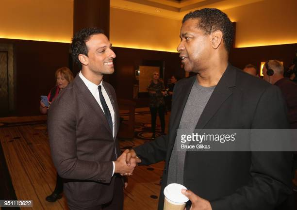 Ari'el Stachel and Denzel Washington chat at The 2018 Tony Award 'Meet The Nominees' photo call press junket at The Intercontinental New York Times...