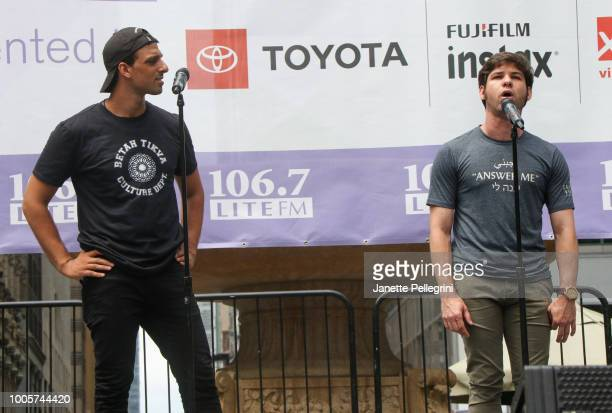 Ari'el Stachel and Etai Benson from the cast of 'The Band's Visit' perform at 1067 LITE FM Broadway in Bryant Park on July 26 2018 in New York City
