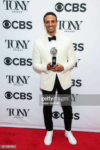 Ari'el Stachel winner of the award for Best Performance by an Actor in a Featured Role in a Musical for 'The Band's Visit' poses in the 72nd Annual...