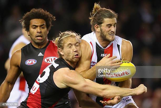 Ariel Steinberg of the Bombers and Josh Bruce of the Saints collide as they go for a mark during the round 14 AFL match between the Essendon Bombers...