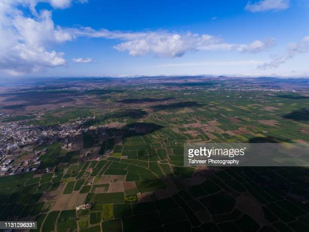 ariel view of agriculture fields and houses - harlequins stock pictures, royalty-free photos & images