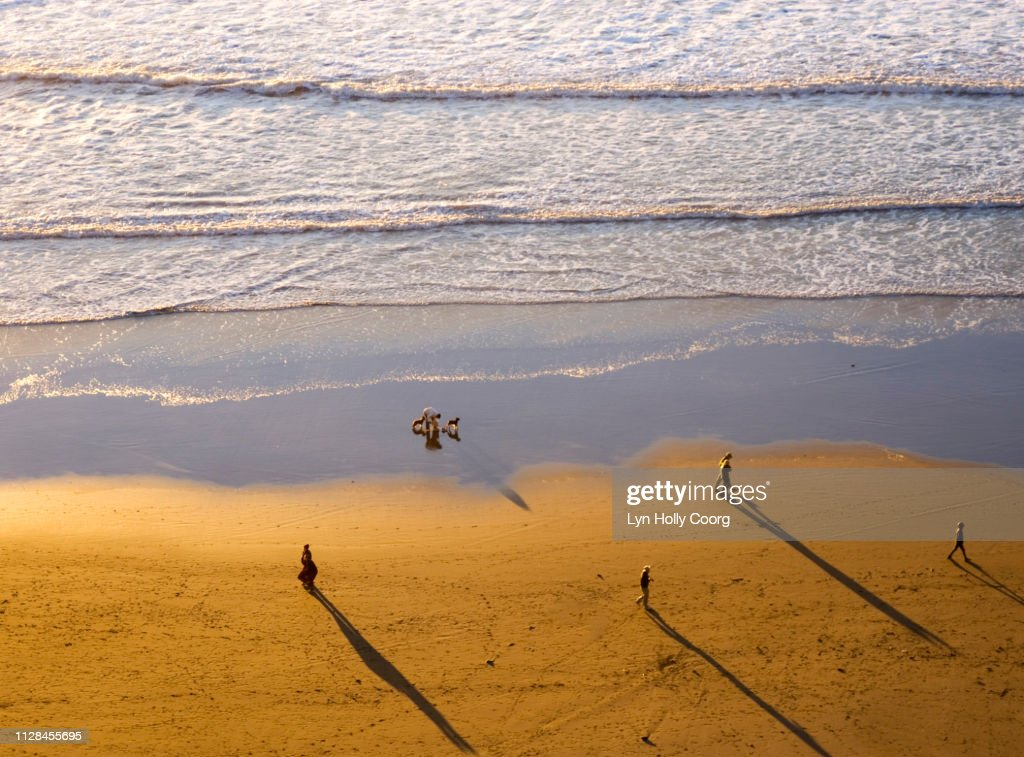 Ariel view of Ocean Beach with people and shadows : Stock Photo