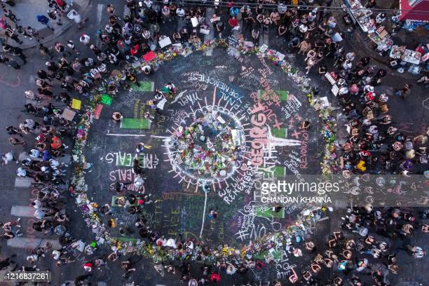TOPSHOT Ariel view of protestors gathered near the makeshift memorial in honour of George Floyd marking one week anniversary of his death on June 1...