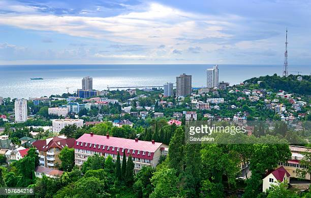 ariel view of sochi under bright skies - sochi stock pictures, royalty-free photos & images