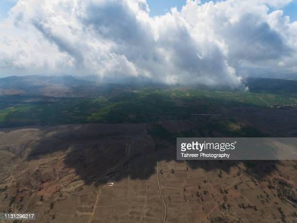 ariel view of uncultivated and cultivated agriculture fields - harlequins stock pictures, royalty-free photos & images