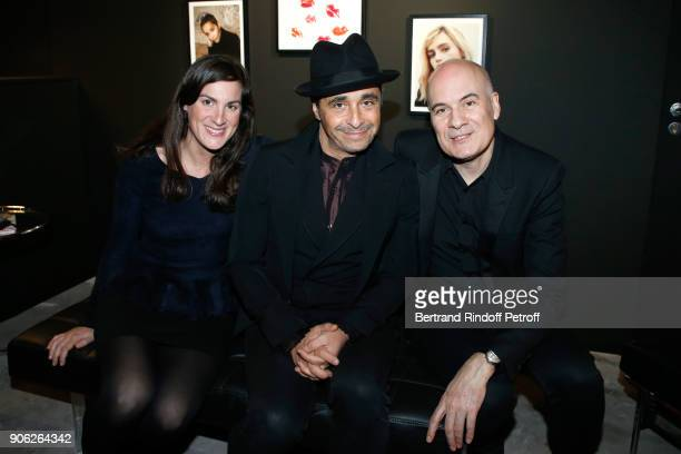 Ariel Wizman sitting between his wife Osnath Assayag and General Manager of YSL Beauty Stephan Bezy attend the YSL Beauty Hotel event during Paris...