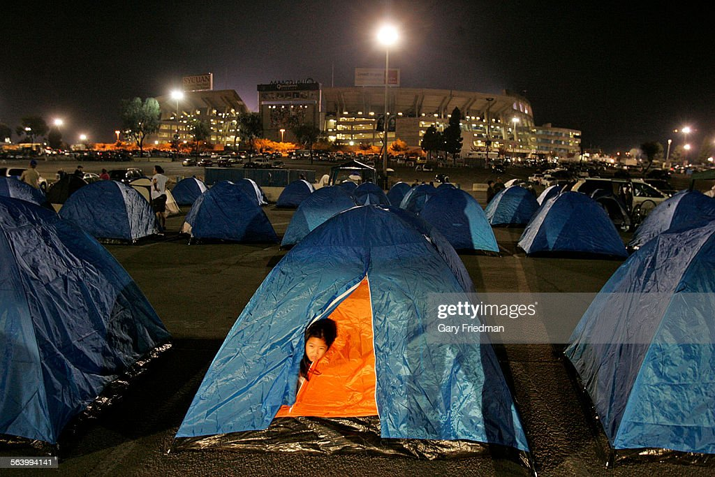 Ariel Yue peeks out from under her tent in the parking lot at Qualcomm & QUALCOMM AT NIGHT. Ariel Yue peeks out from under her tent in the ...