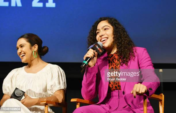Ariela Barer and Allegra Acosta speak onstage during Hulu's 'Runaways' panel at 2018 New York Comic Con at The Theater at Madison Square Garden on...