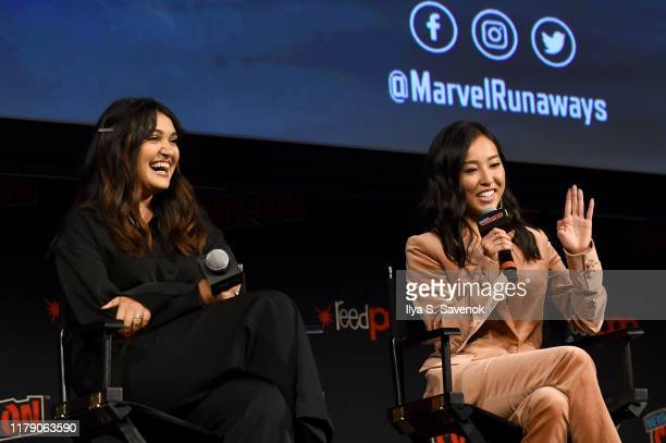 Ariela Barer and Lyrica Okano speak onstage during the Marvel's Runaways Panel at New York Comic Con 2019 Day 2 at Hulu Theater at Madison Square...