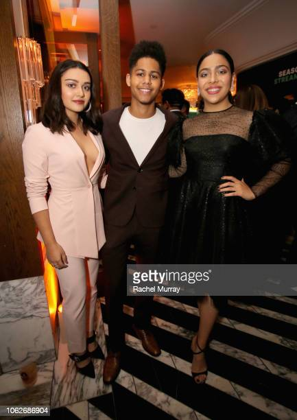 Ariela Barer Rhenzy Feliz and Allegra Acosta attend the 2018 Hulu Holiday Party at Cecconi's Restaurant on November 16 2018 in Los Angeles California
