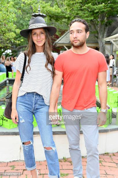 Arielle Charnas and Brandon Charnas attend Harper's BAZAAR X Sam Edelman MidSummer Hamptons Event on August 2 2018 in Southampton New York