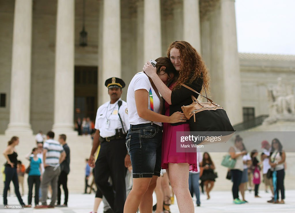 Arielle Cronig (L) and Elaine Cleary embrace outside of the U.S. Supreme Court after the ruling in favor of same-sex marriage June 26, 2015 in Washington, DC. The high court ruled that same-sex couples have the right to marry in all 50 states.