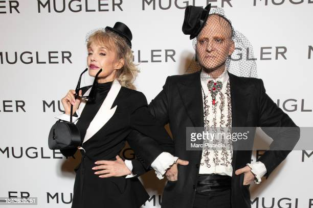 """Arielle Dombasle and Ali Mahdavi attend the """"Thierry Mugler : Couturissime"""" Photocall as part of Paris Fashion Week at Musee Des Arts Decoratifs on..."""