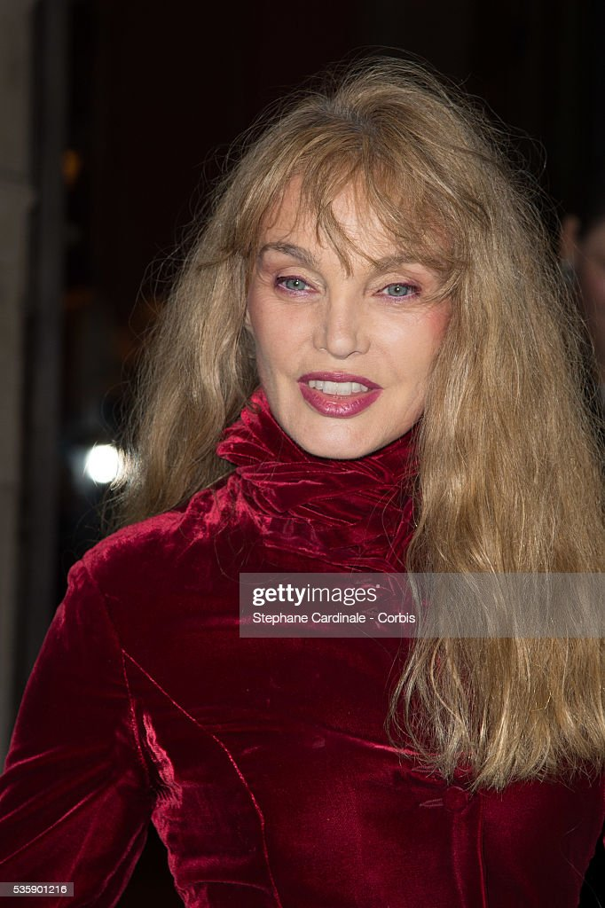 Arielle Dombasle arrives at a Ralph Lauren Collection Show and private dinner at Les Beaux-Arts de Paris on October 8, 2013 in Paris, France. On this occasion Ralph Lauren celebrates the restoration project and patron sponsorship of 'L'Ecole des Beaux-Arts'.