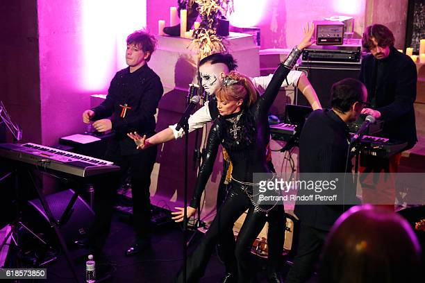 Arielle Dombasle dancing with JeanMich as she performs for the release of the Album La Riviere Atlantique Noche de los muertos event during the...