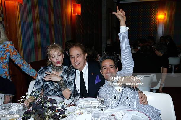 Arielle Dombasle Gilles Dufour and Vincent Darre attend the Dinner following the Private View of Francoise Sagan Photographer Photo Exhibition at...
