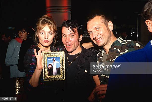 Arielle Dombasle Pierre Commoy and Gilles Blanchard attend a fashion week Party at Les Bains Douches in the 1990s in Paris France