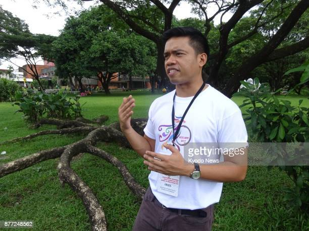 Aries Arugay an associate professor of political science at the University of the Philippines speaks in an interview with Kyodo News at his...