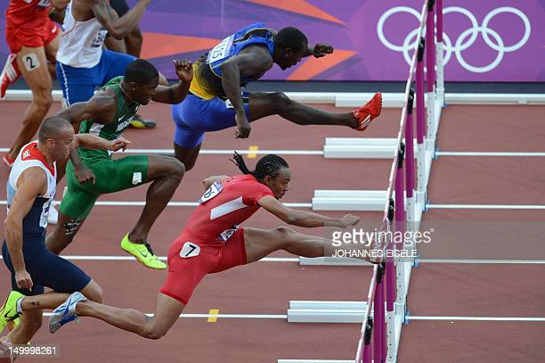 US' Aries Merritt and Barbados' Ryan Brathwaite compete in the men's 110m hurdles semifinals at the athletics event of the London 2012 Olympic Games...