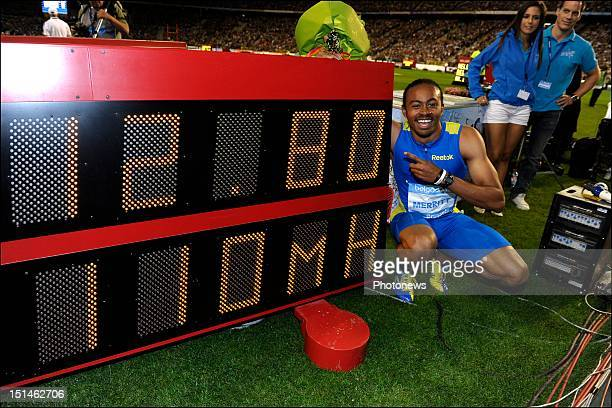 Aries Merritt of the United States celebrates winning the 110M Hurdles with a new world record time of 12.80 seconds on the 14th and last leg of the...