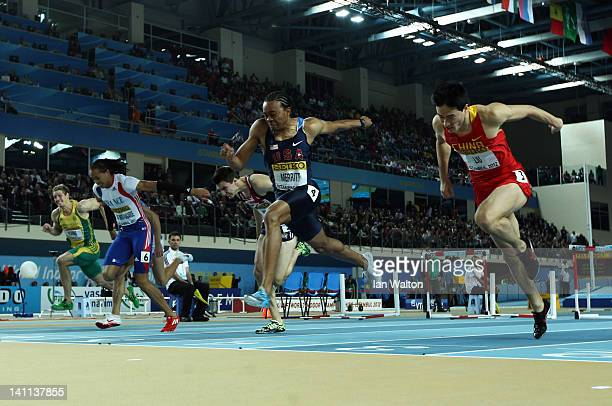 Aries Merritt of the United States crosses the line to win gold ahead of silver medalist Lui Xiang of China in the Men's 60 Metres Hurdles Final...
