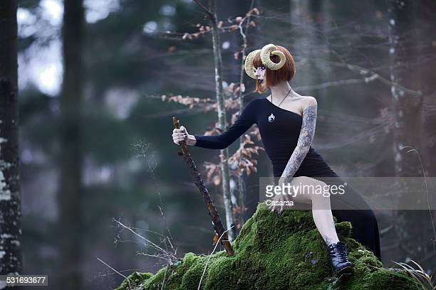 aries woman portrait in the wild woods - astrology sign stock photos and pictures