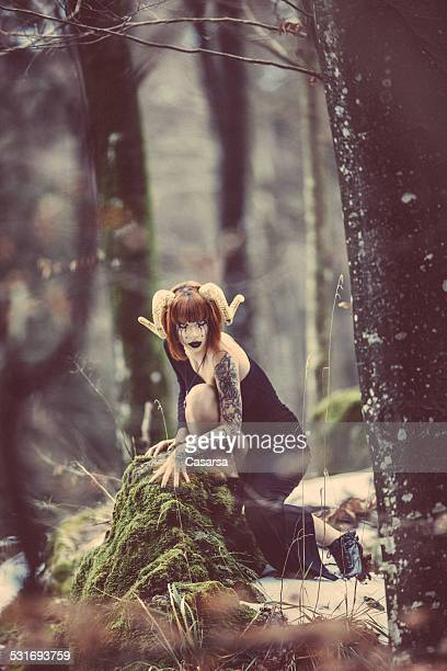 Aries woman portrait in the wild woods