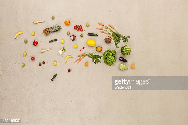 ariety of vegetables and fruits on beige background